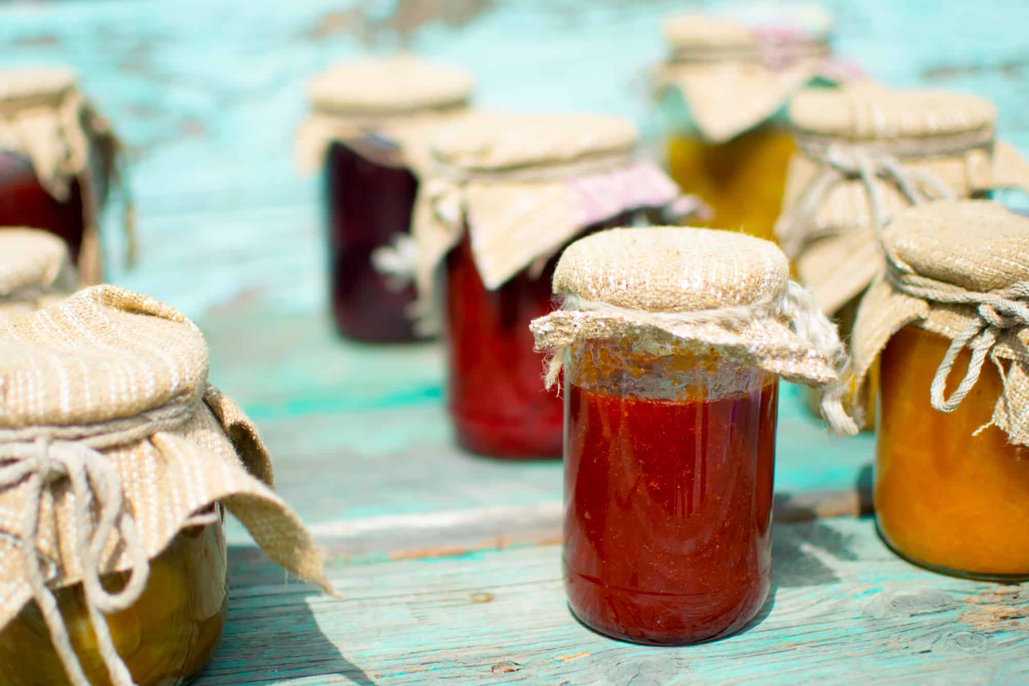 Several mason jars filled with fresh jam