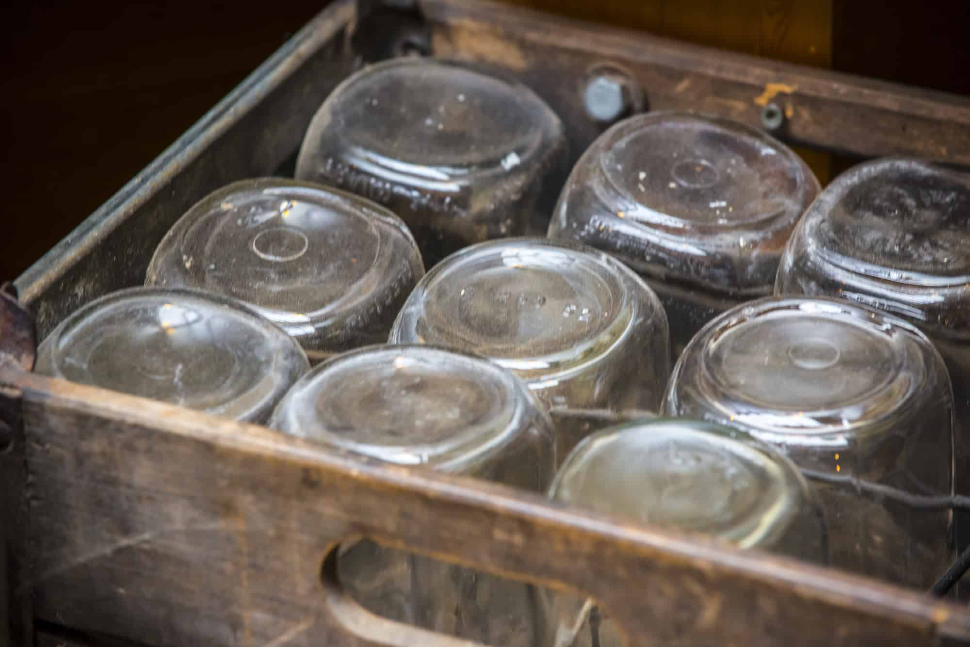 Rustic style wooden box with old fashion glass jars