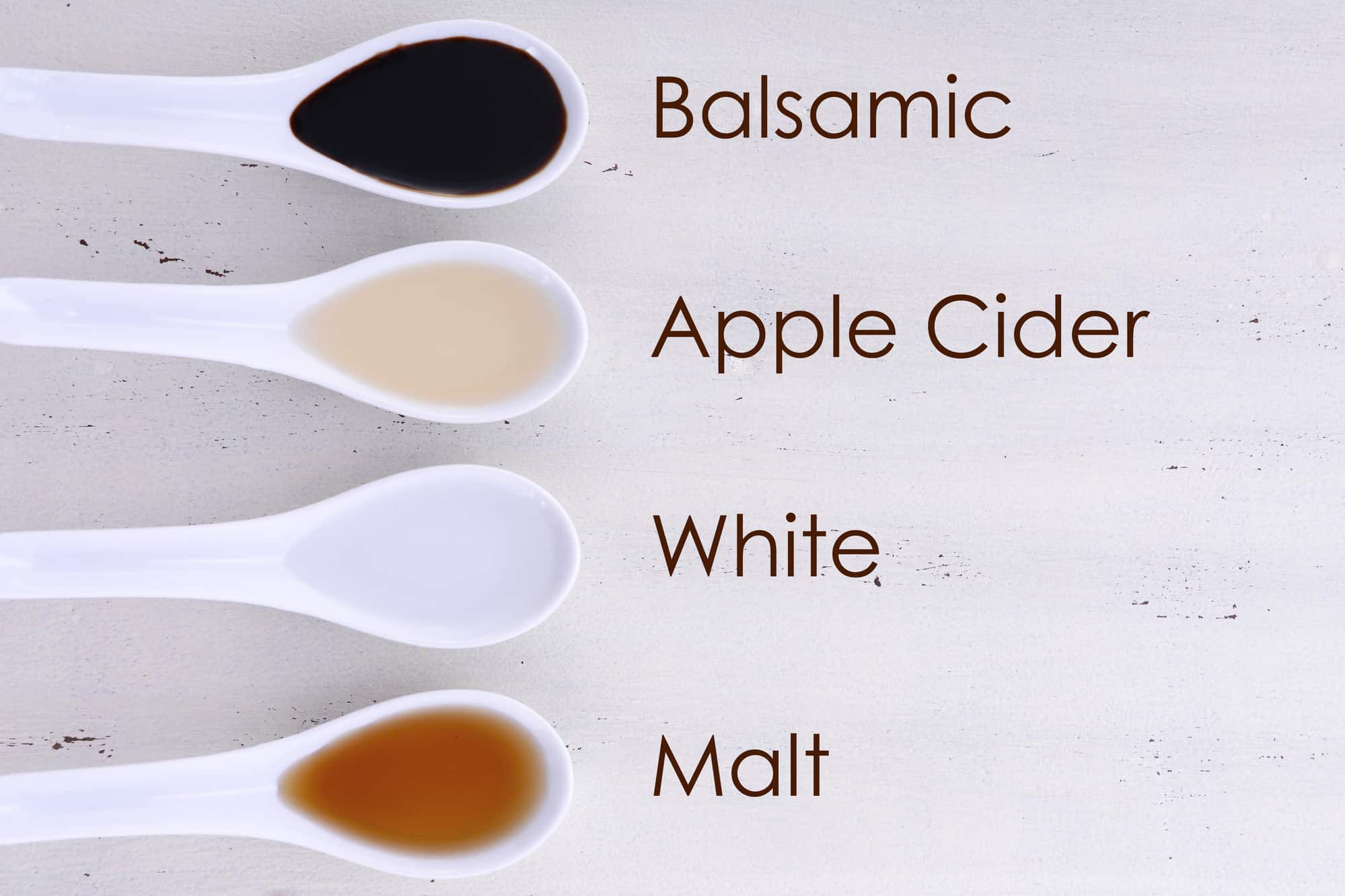 Serving size samples of different types of vinegar including Balsamic, Apple Cider, White and Malt vinegars, with text names added