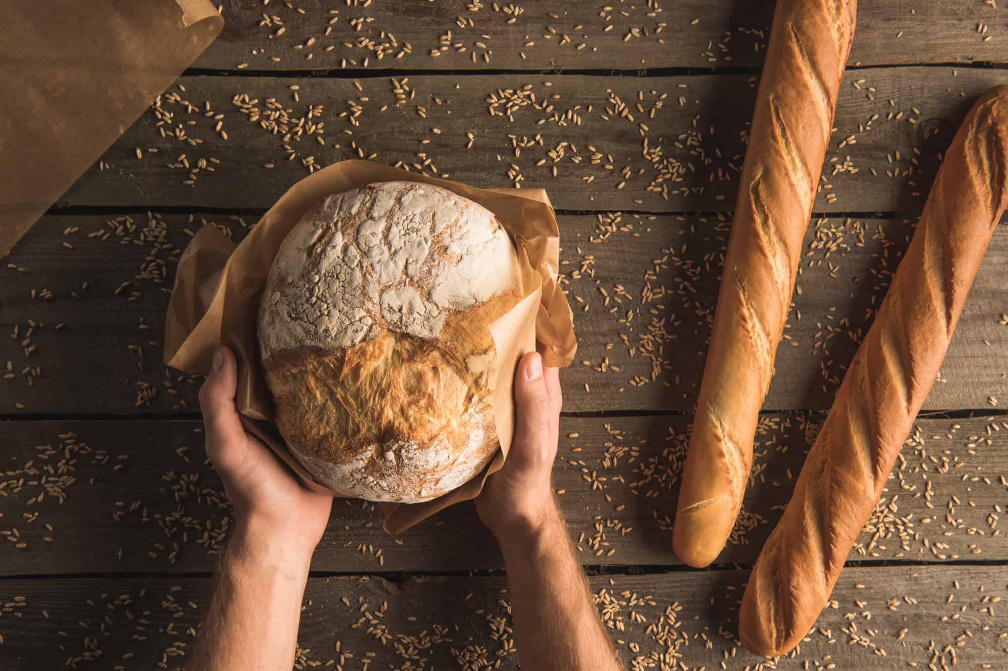 Freshly baked organic bread on a wooden table