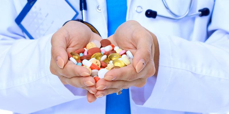 doctor holding prescription drugs
