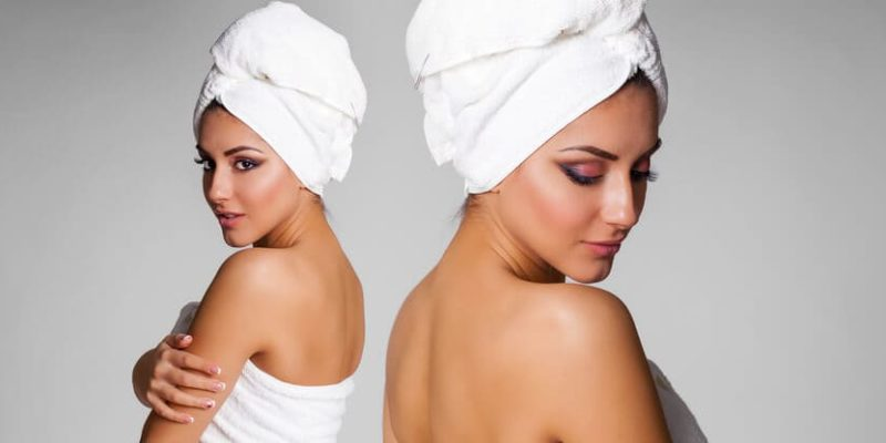 photo of woman with a bath towel wrapped around her hair
