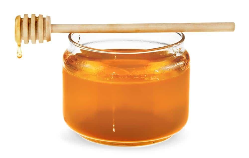 photo of jar of honey and honeycomb