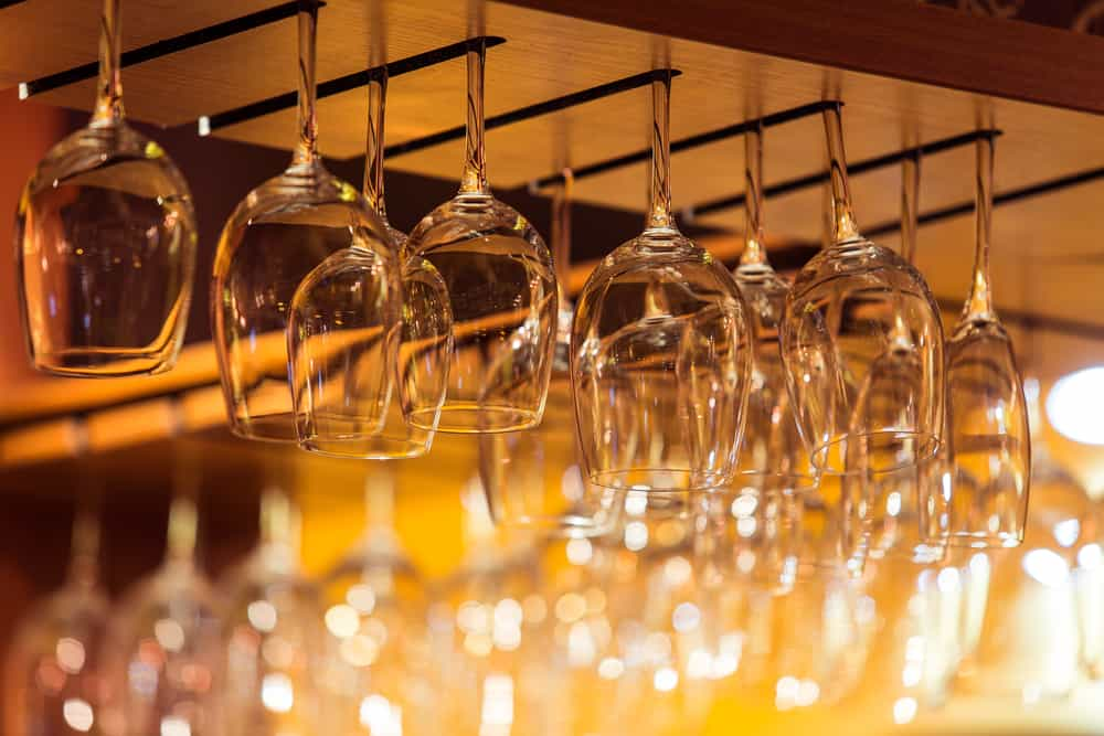 wine glasses hanging in the bar