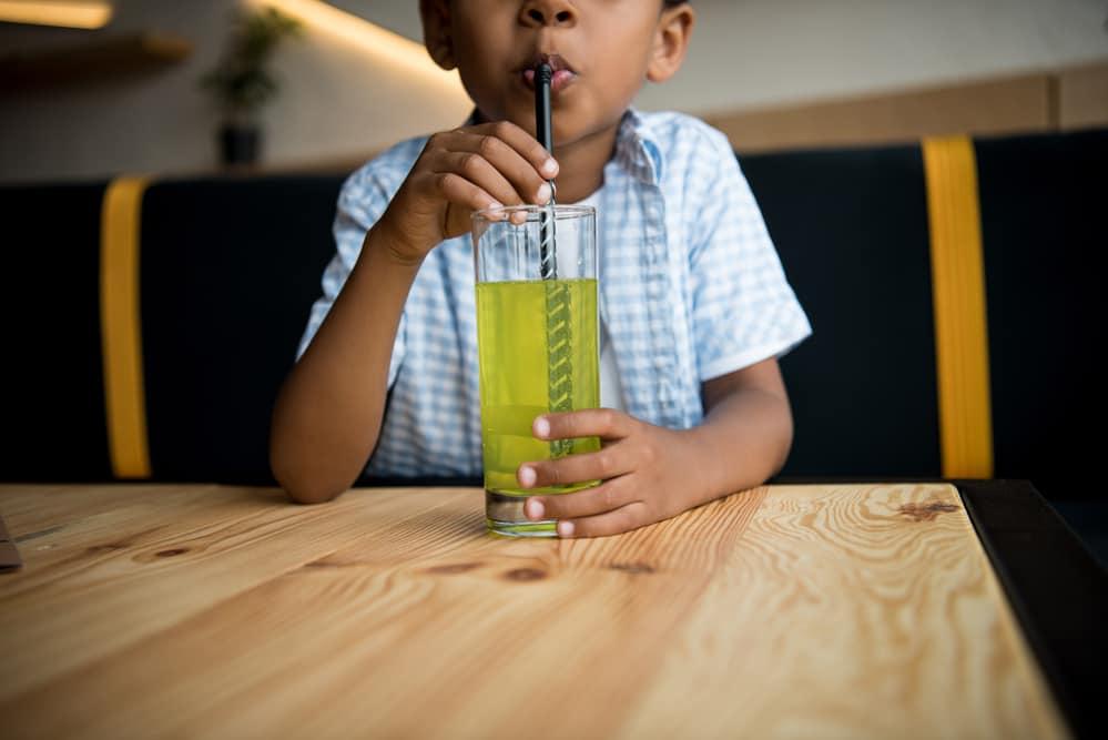 boy drinking electrolytes