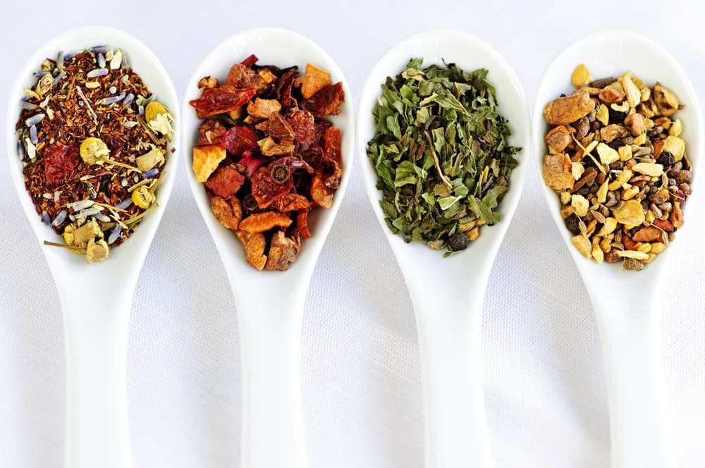 Herbal wellness dried tea in four spoons