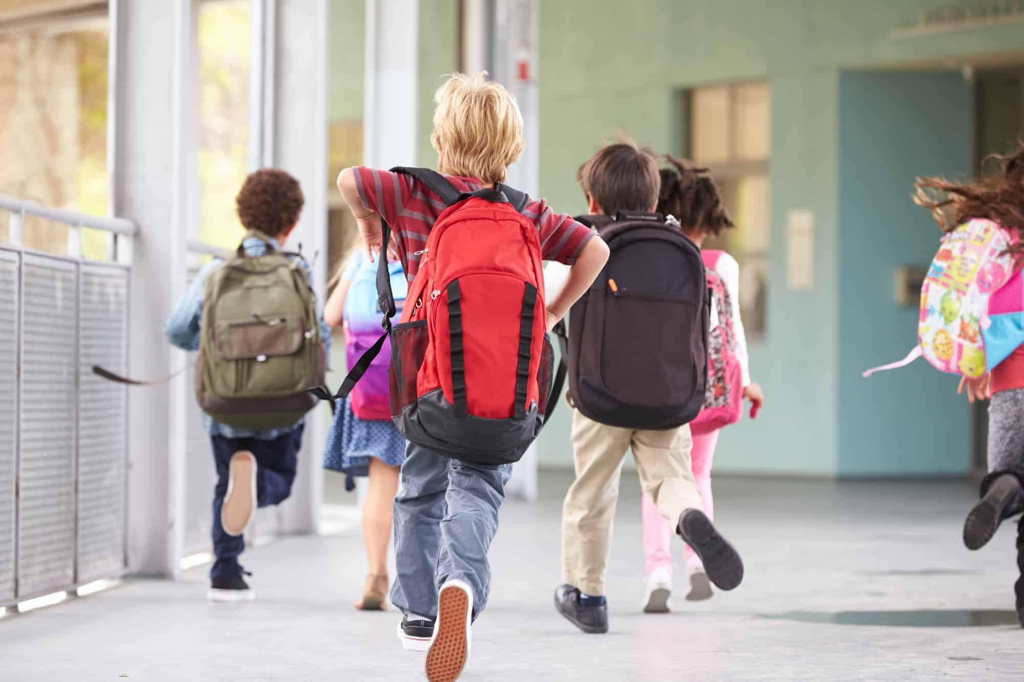 children running to class in elementary school