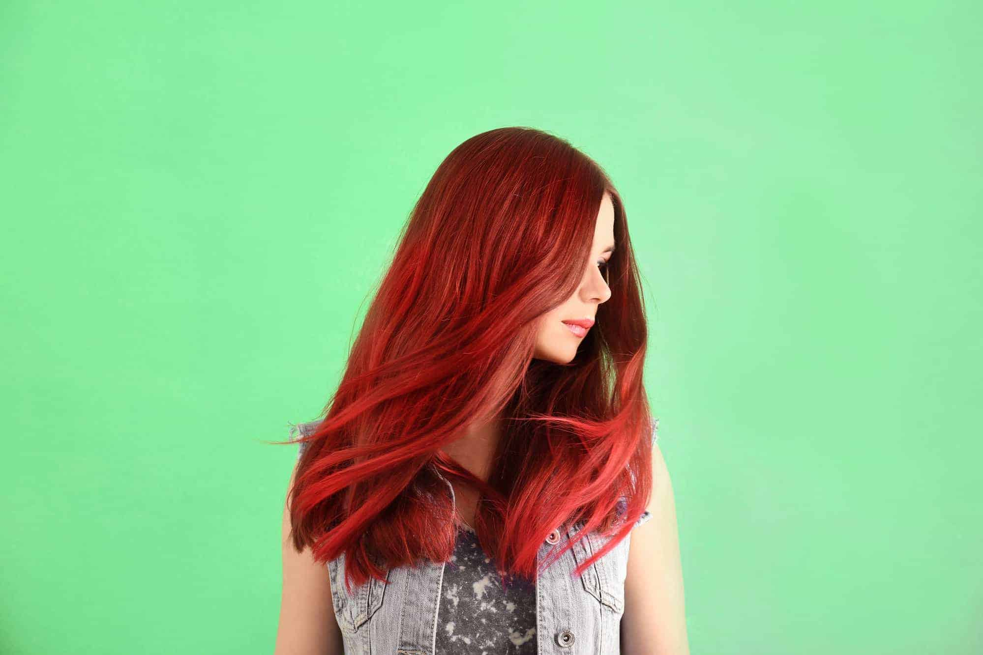 Beautiful young woman with red dyed hair