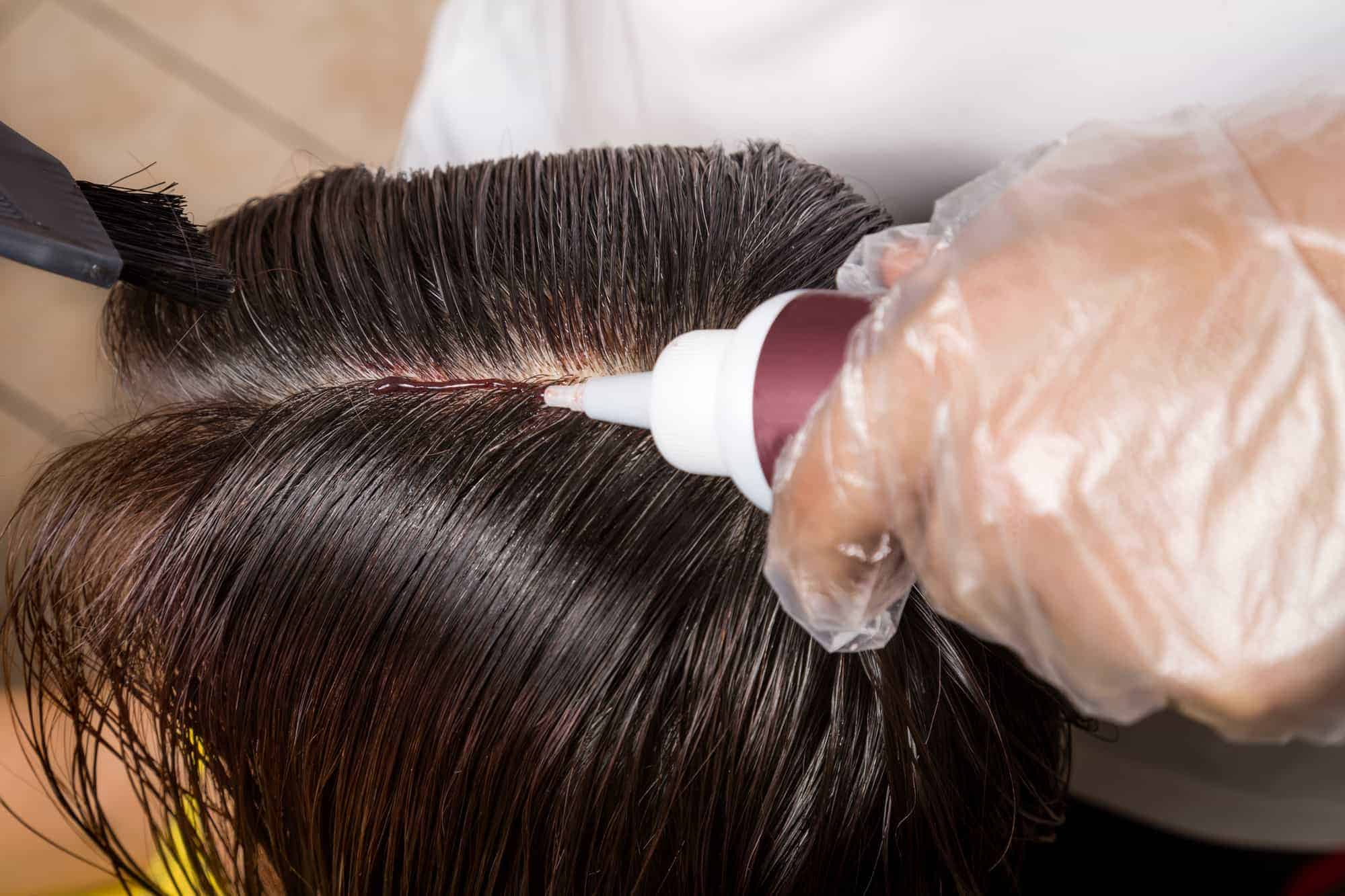 chemical hair color dye onto hair roots