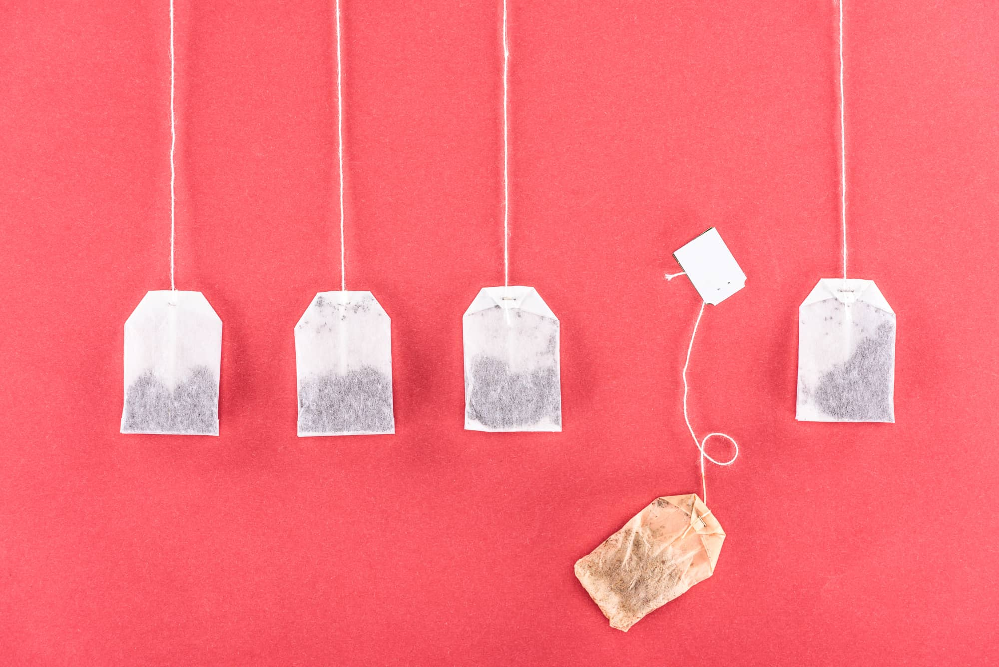 tea bags against a pink wall