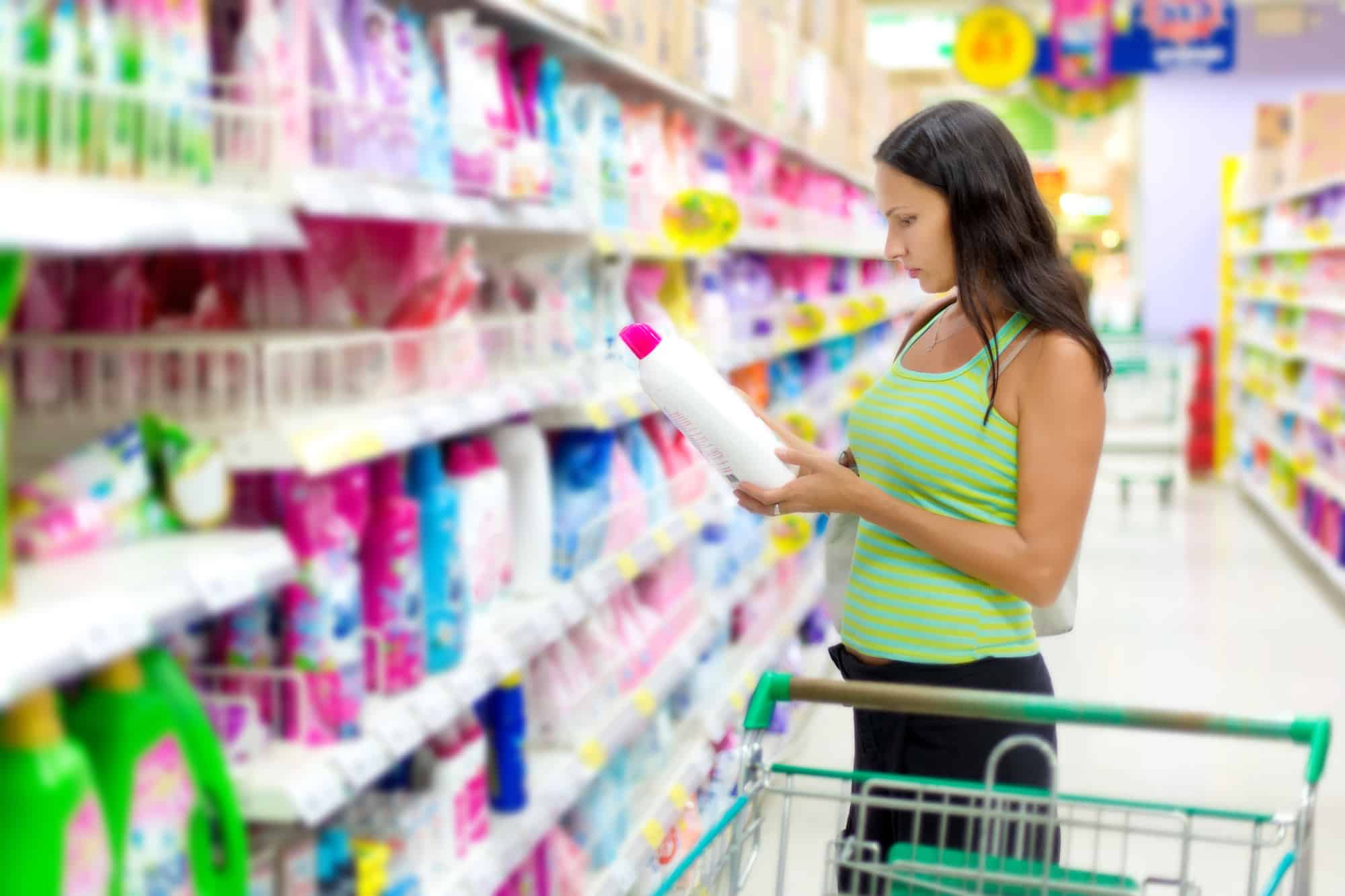 woman selecting non-toxic cleaning products at grocery store