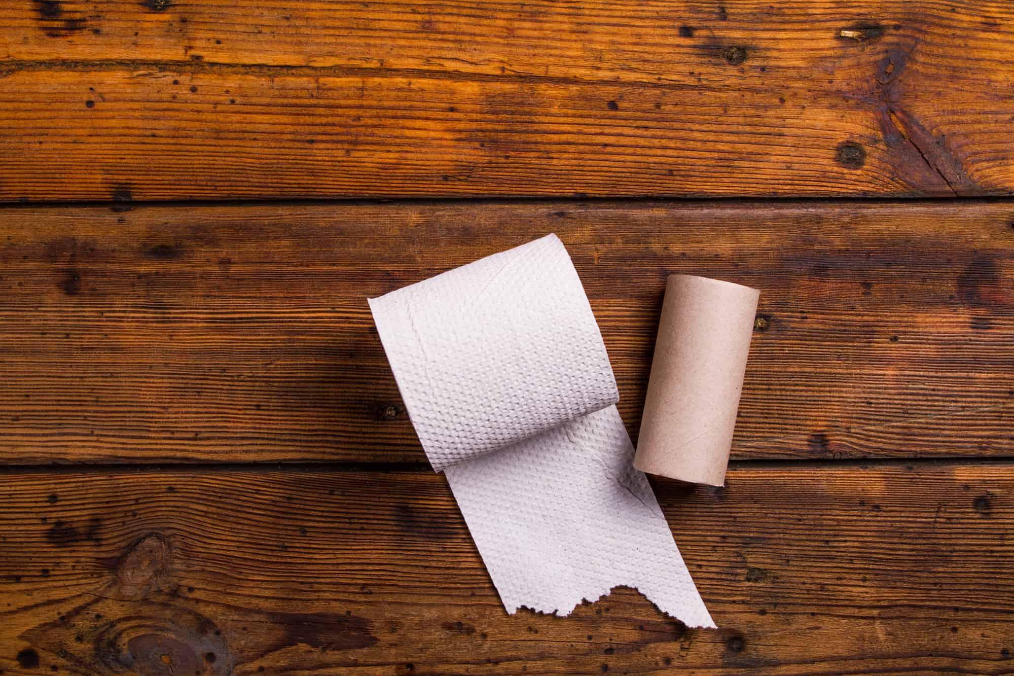Toilet paper against wood flooring
