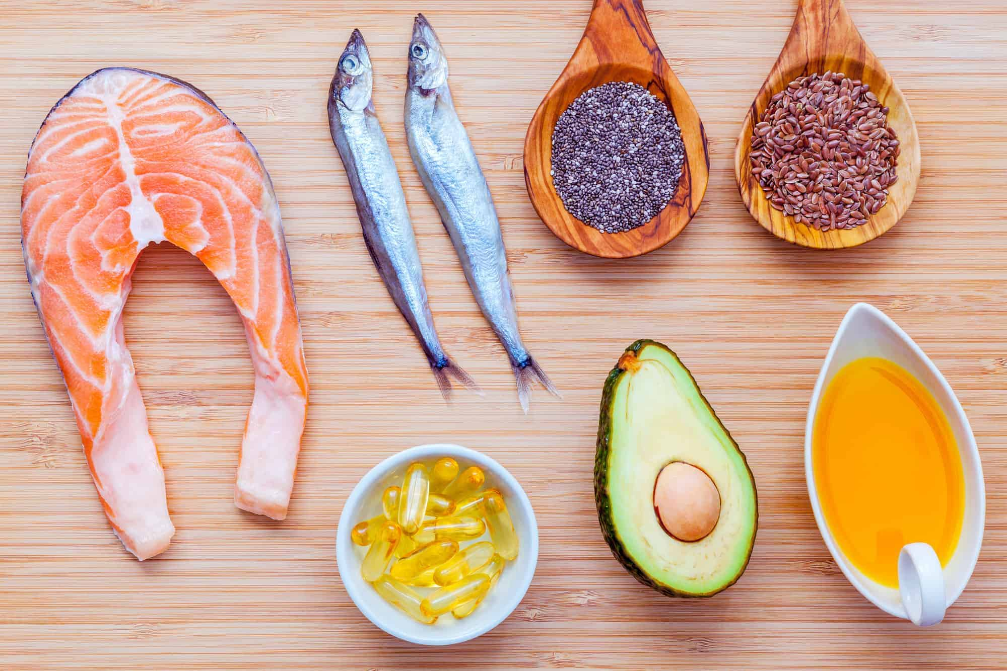 Selection of healthy fats on bamboo cutting board