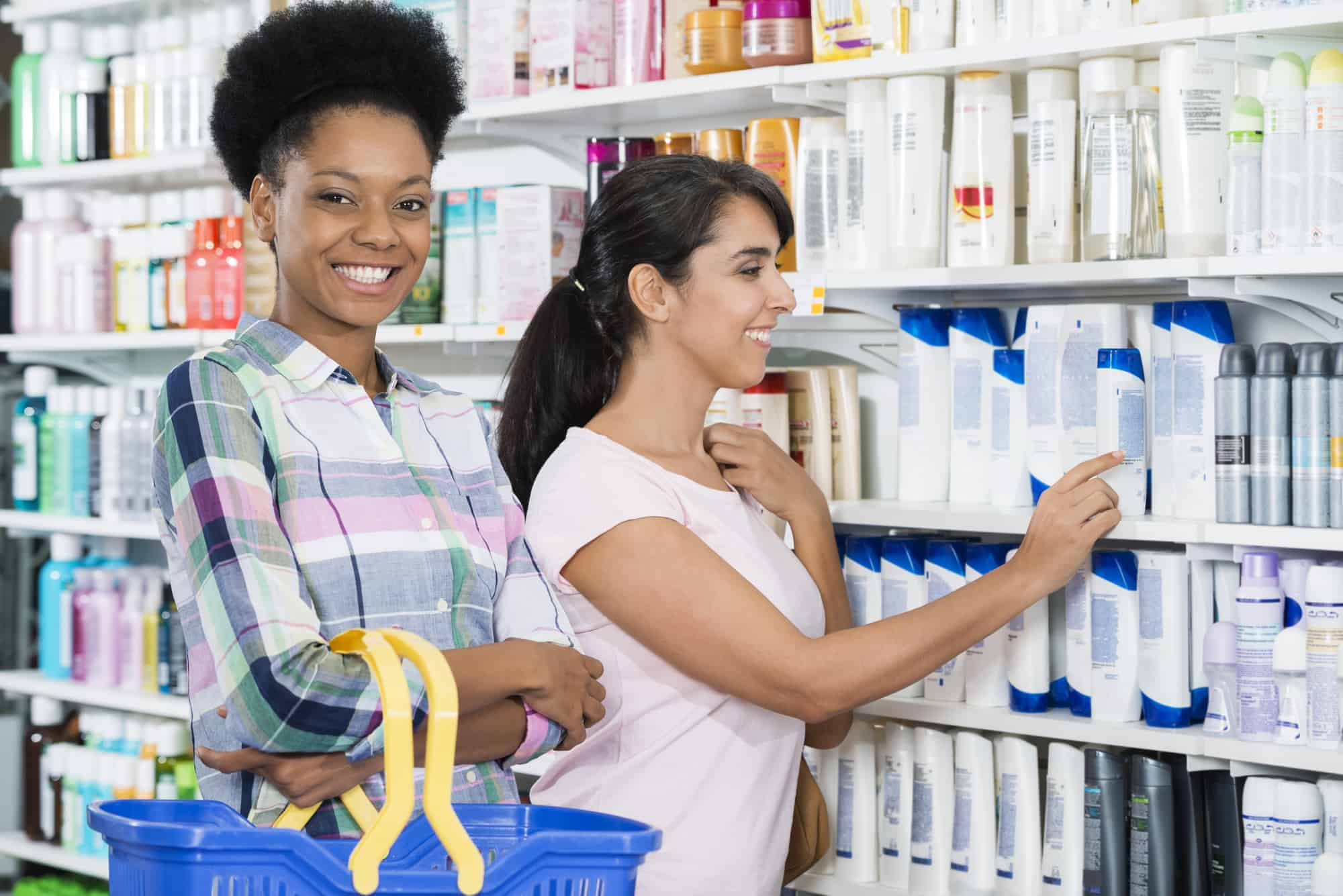 Portrait of confident woman smiling while friend choosing product