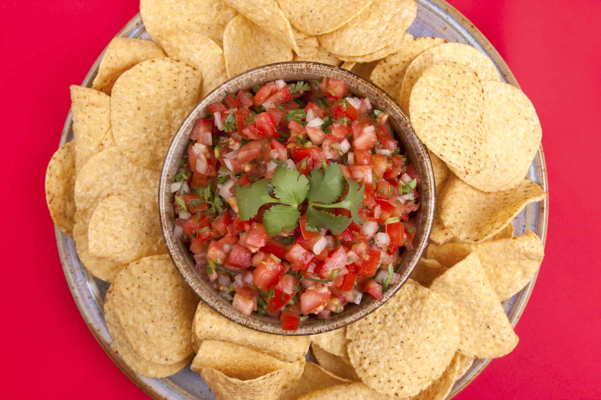 A view from above of chips and homemade salsa