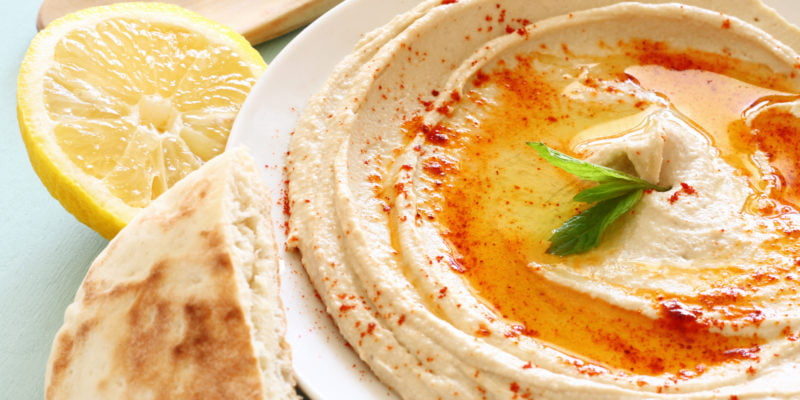 hummus with pita and a slice of lemon