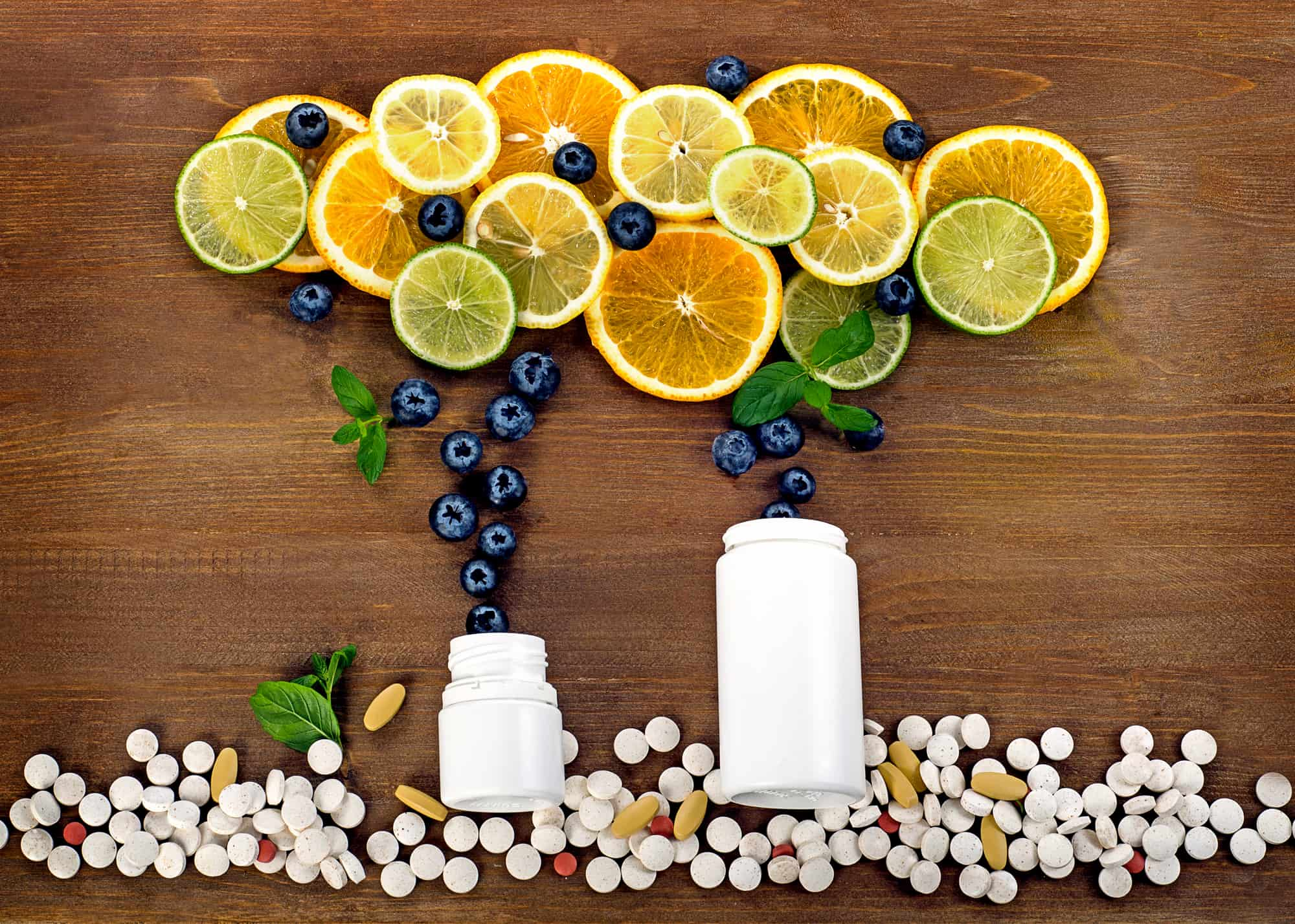 citrus fruits falling into supplement bottles