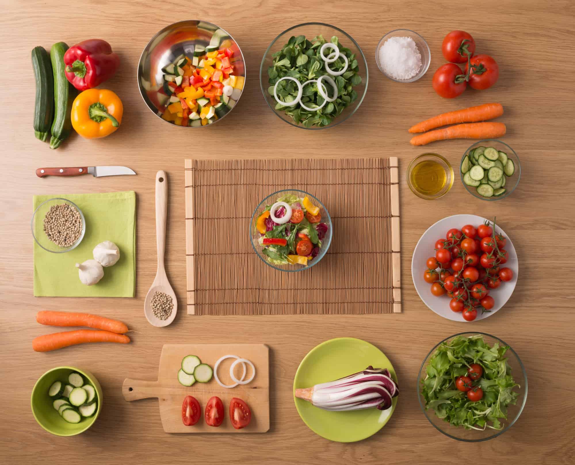 salads and kitchen wooden utensils