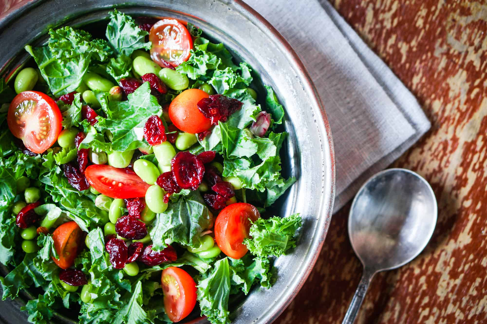 beautiful organic vegan salad with tomatoes, butter lettuce & soybeans