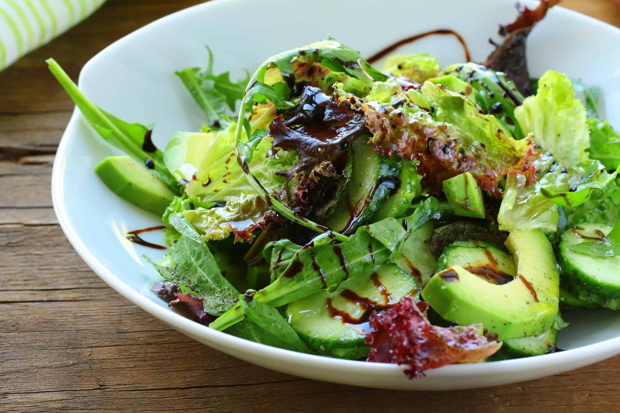 organic salad with avocado and balsamic dressing