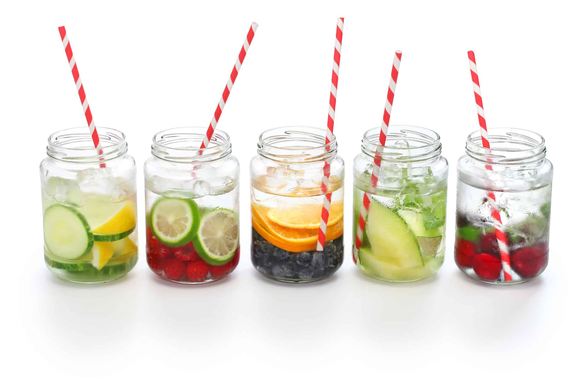 several glasses with ice water and fruit