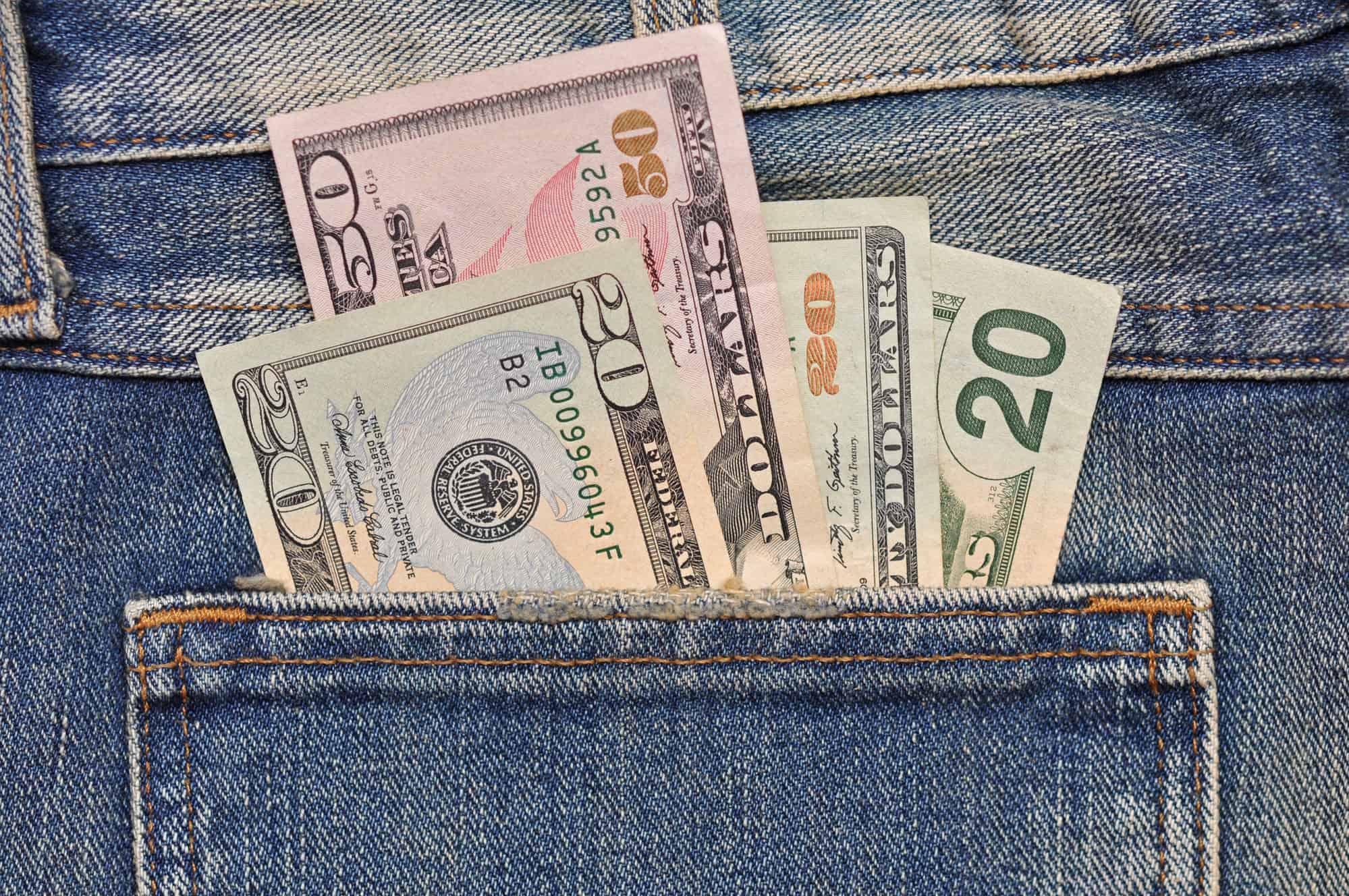 Money coming out of jean pocket