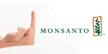 Thrive Market CWoman giving Monsanto The Finger