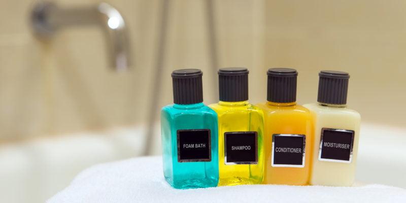 Foam bath, shampoo, conditioner and moisturizer in hotel bathroom