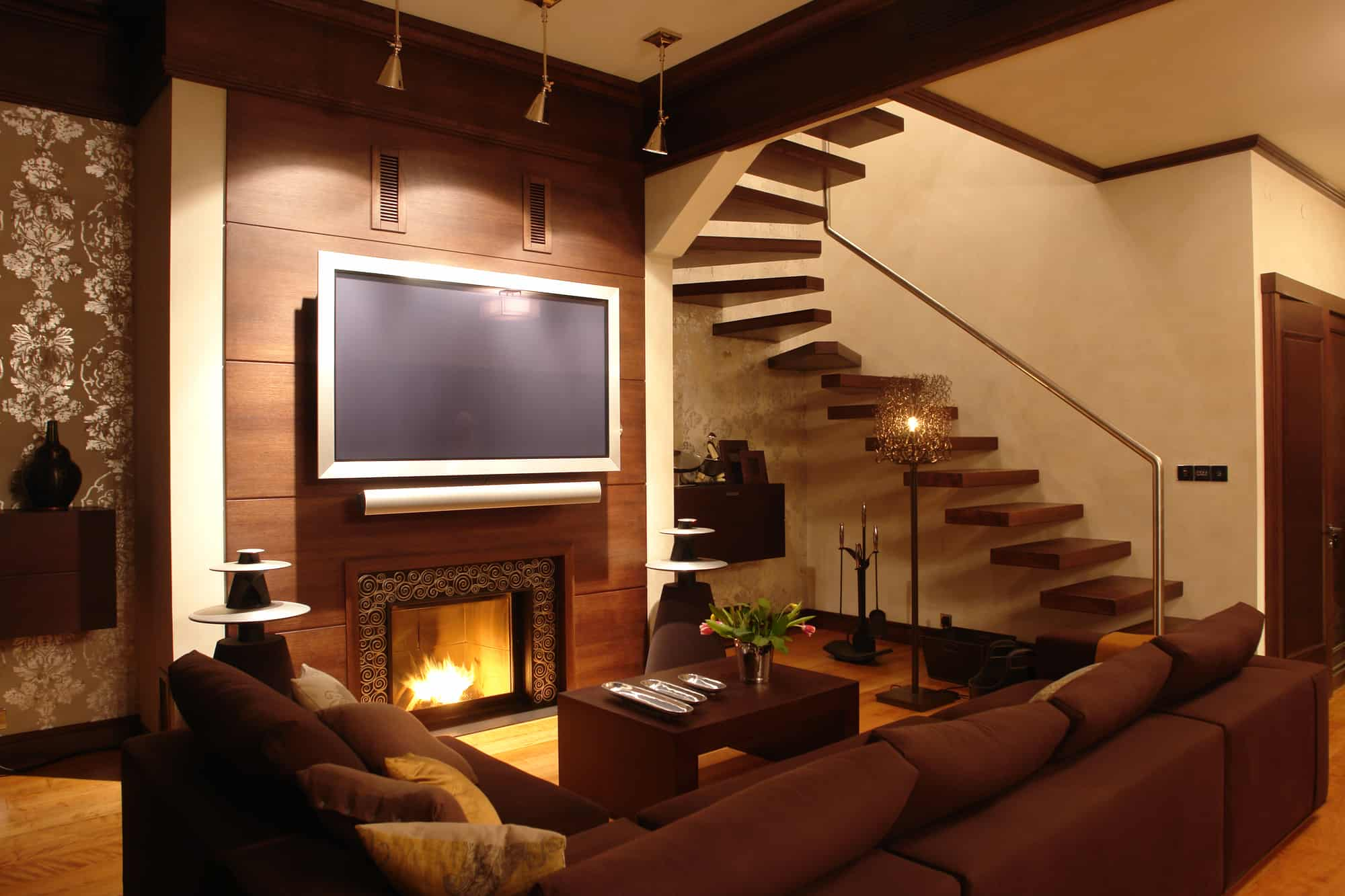 Downstairs living room with view of television that has fire retardants inside