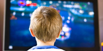 child sitting in front of toxic american television with fire retardants