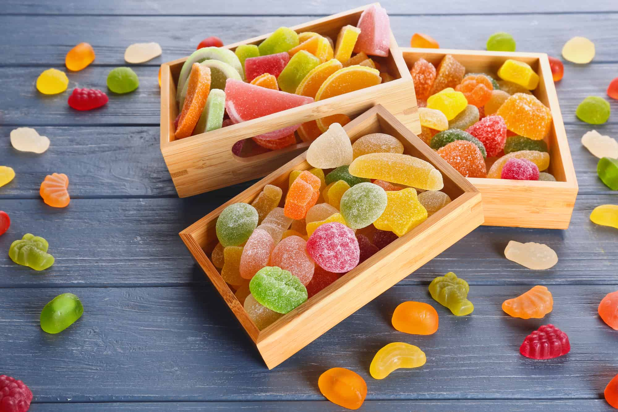 Composition of organic jelly candies on wooden background