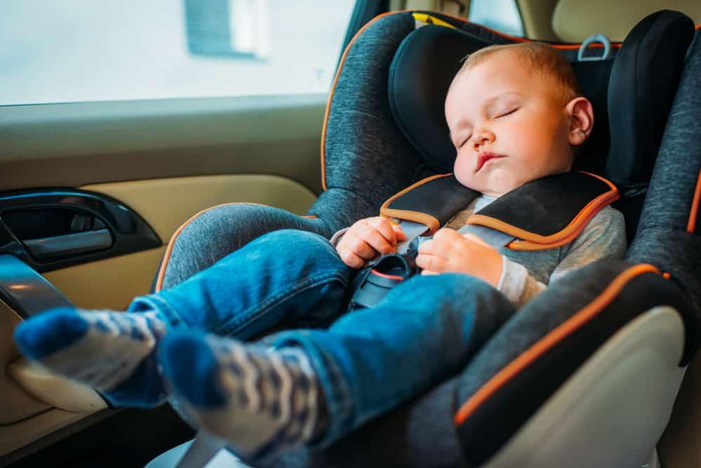 beautiful baby boy in car seat