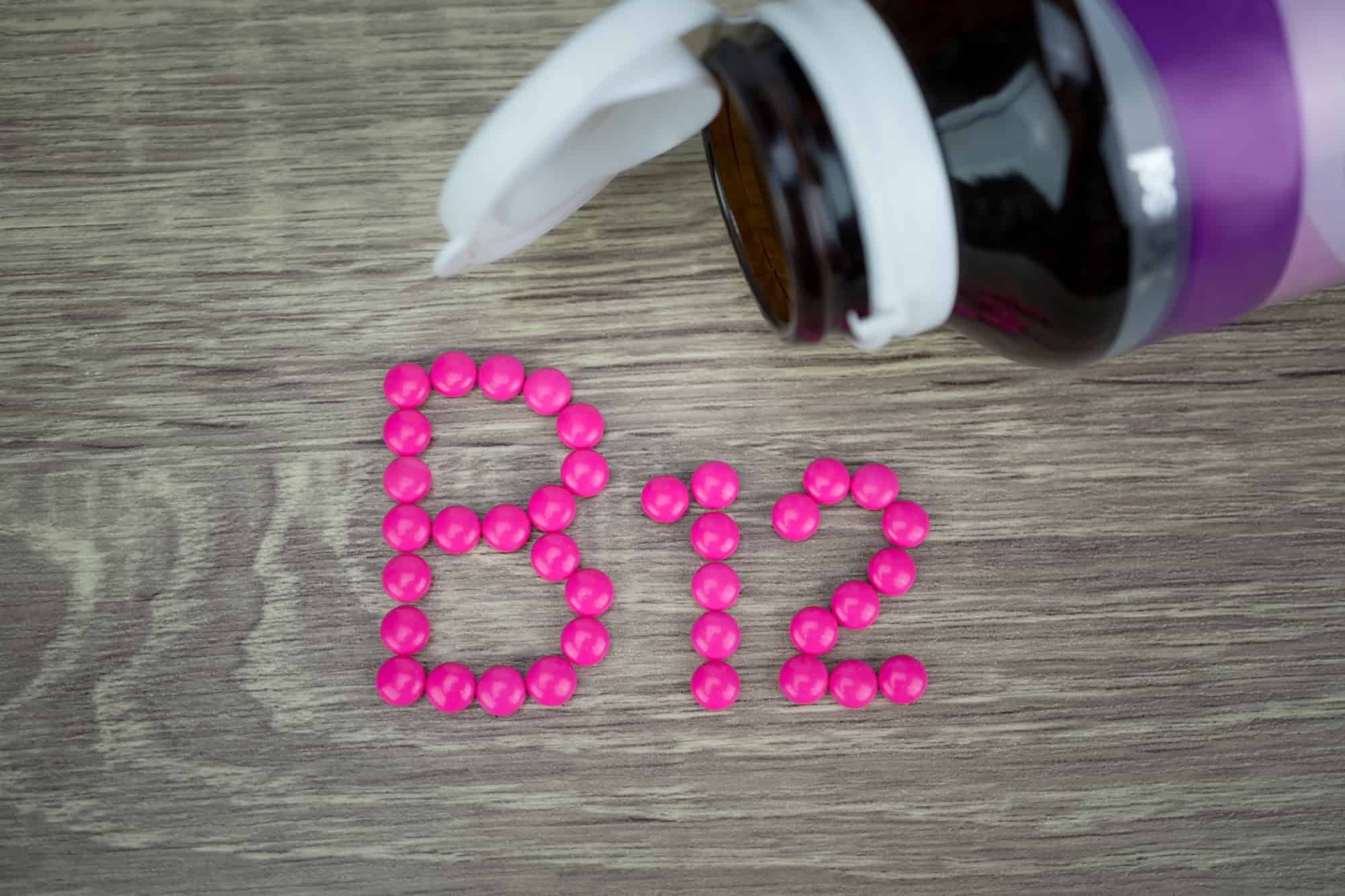 Pink pills forming shape to B12 alphabet