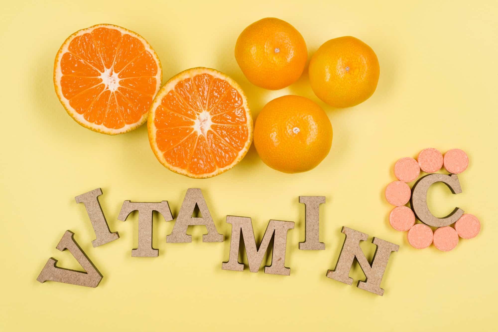 Word vitamin C is written in wooden letters