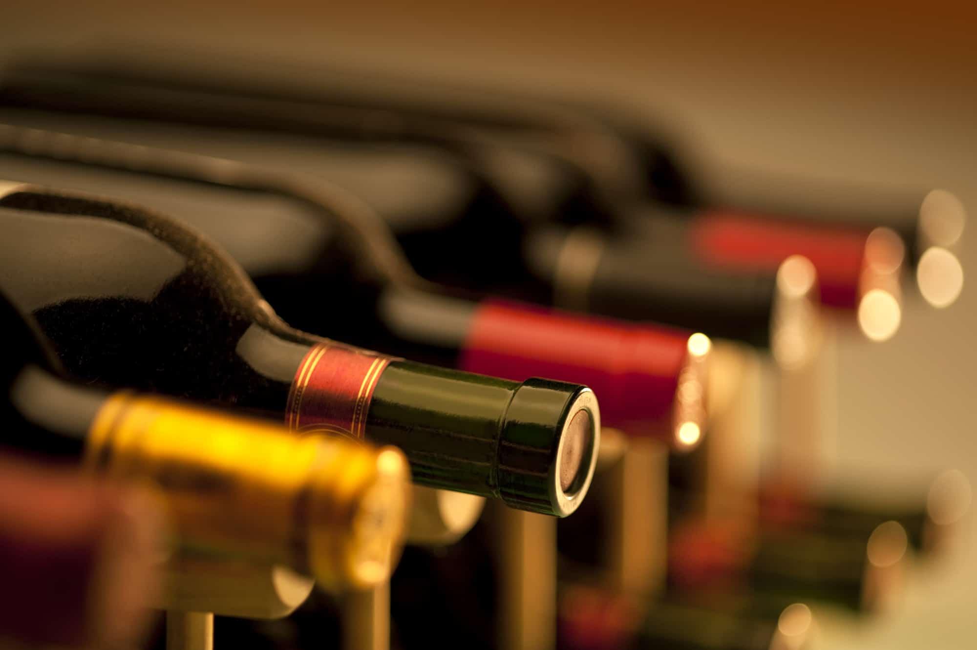 Several bottles of wine set on their side