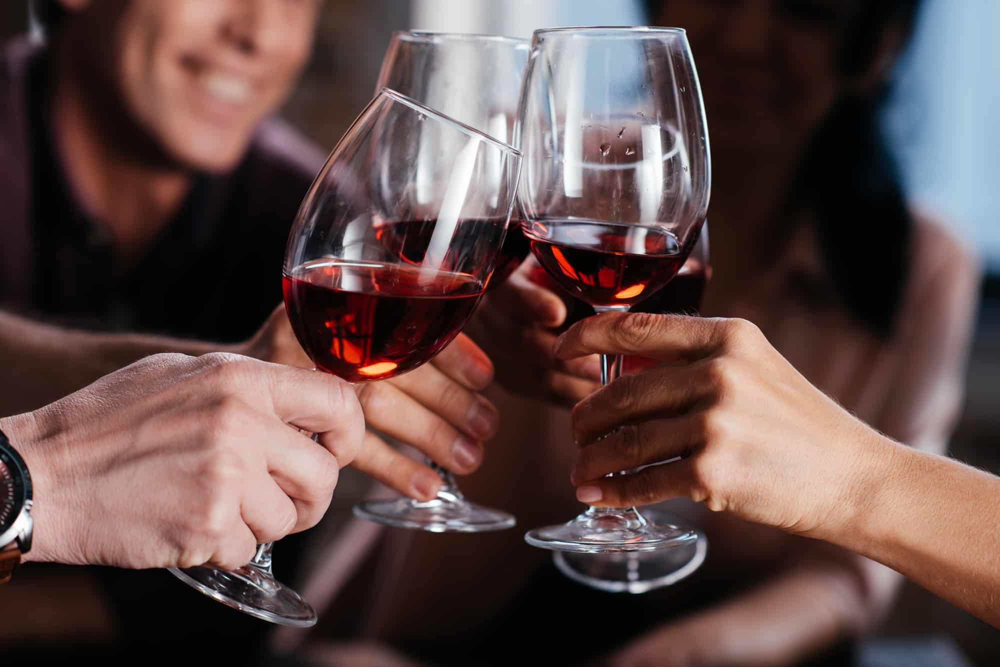 Friends clinging wine glasses