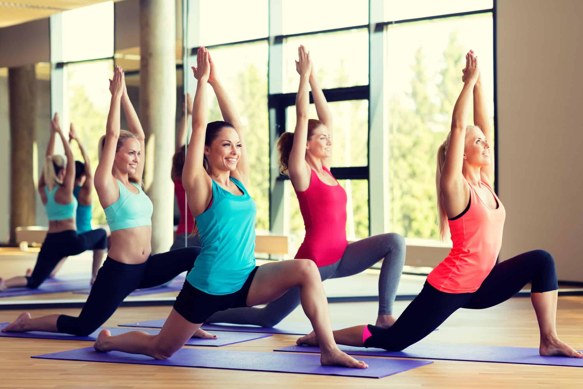 women doing yoga pose during class