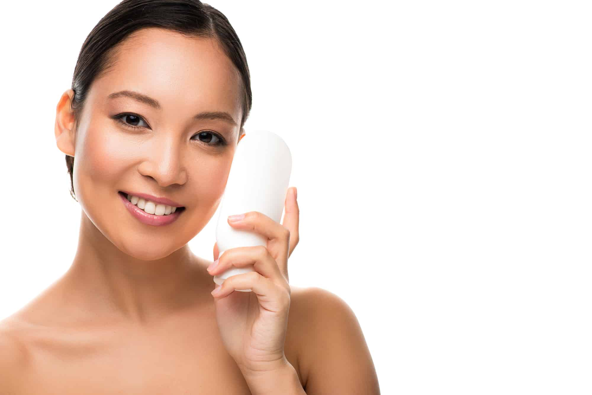 beautiful asian woman holding up bottle of lotion