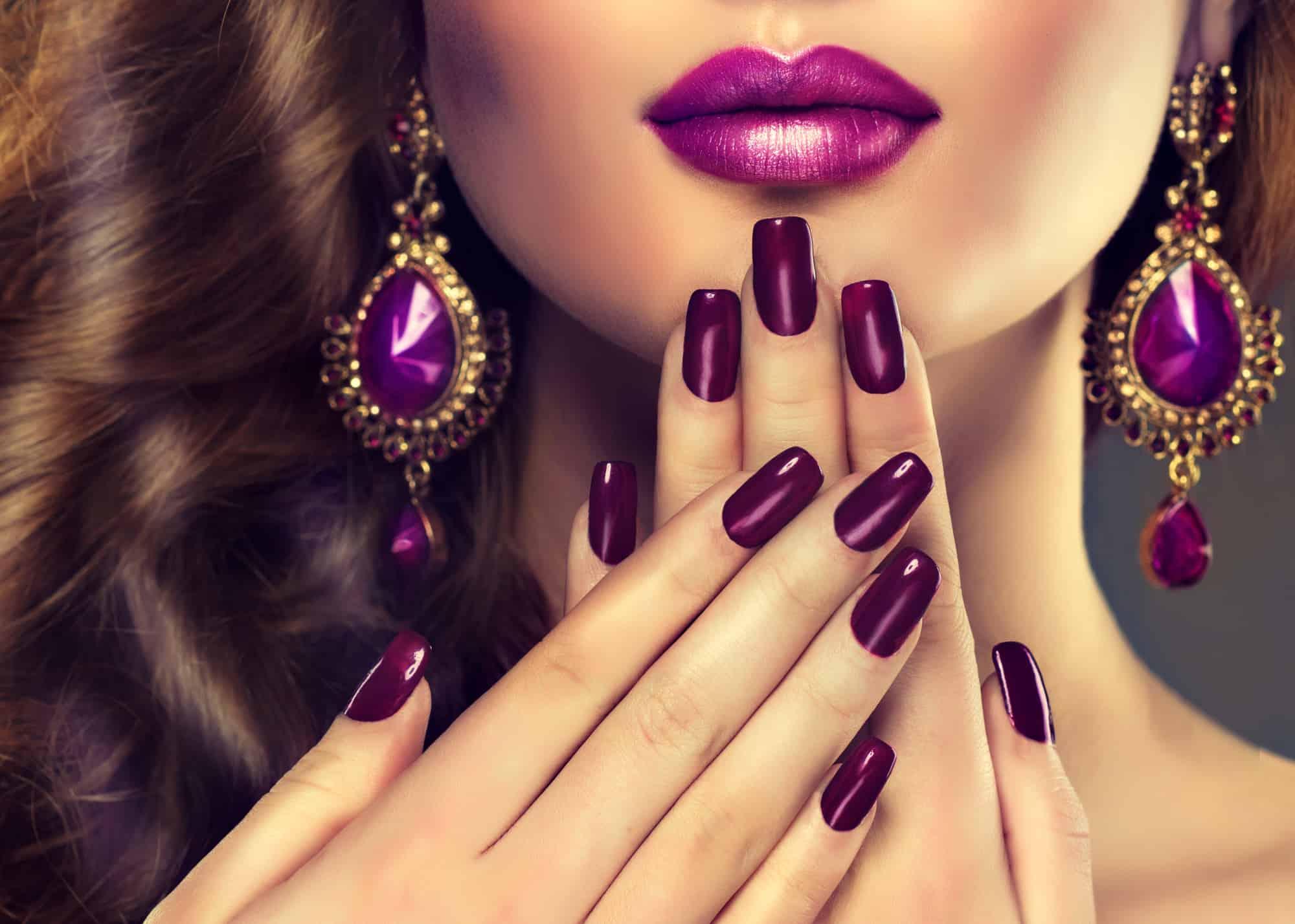 beautiful Indian woman wearing 5 free purple nail polish