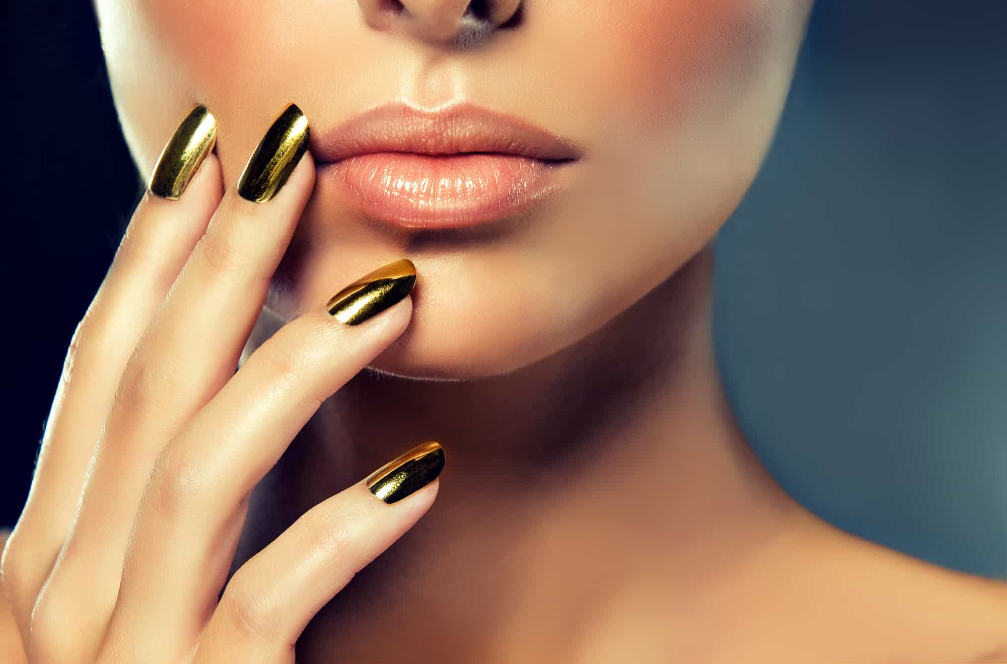 beautiful woman wearing gold non-toxic nail polish