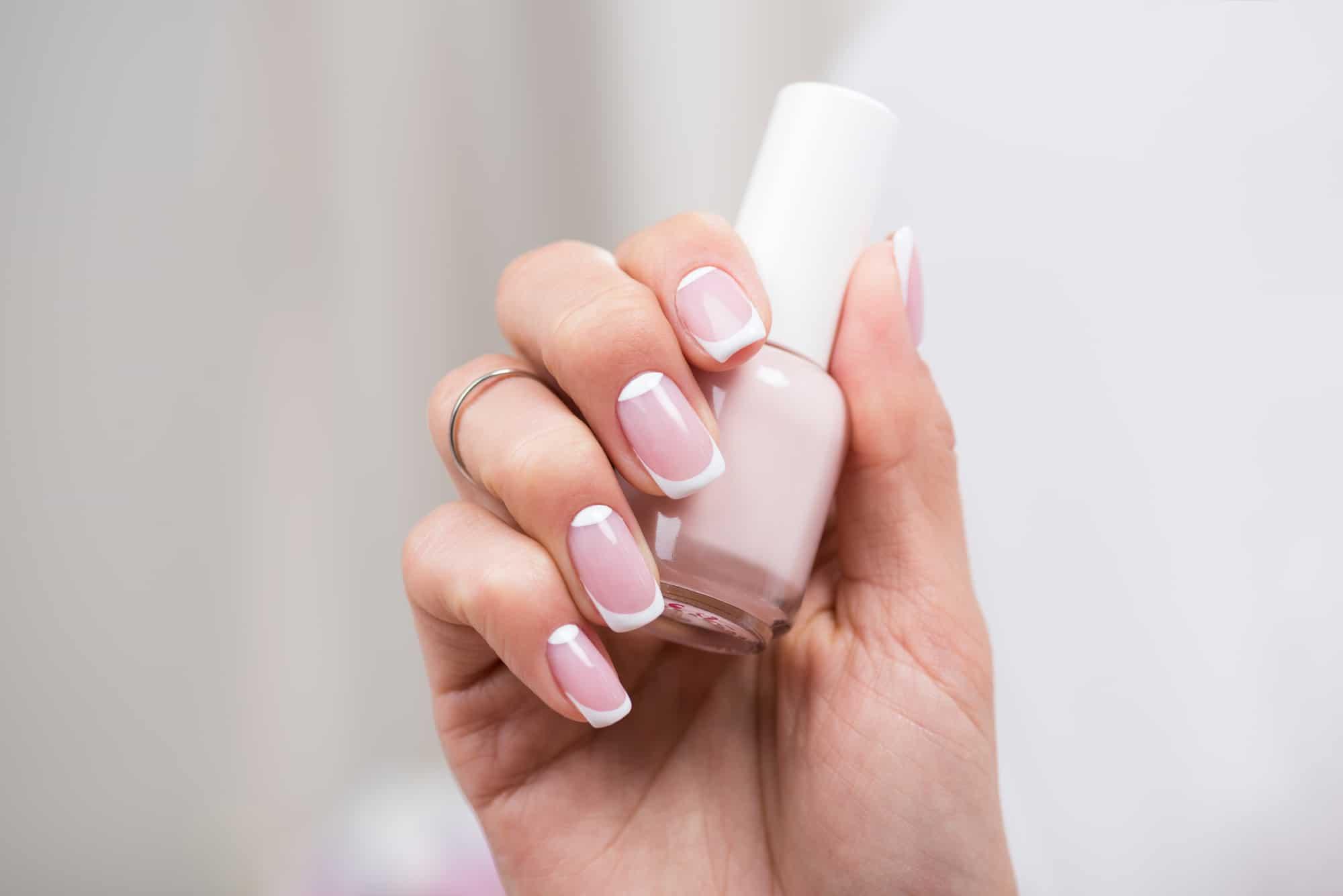 woman wearing 9 free french manicure nontoxic nail polish