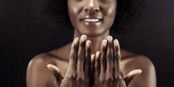 beautiful black woman wearing 11 free non-toxic nail polish