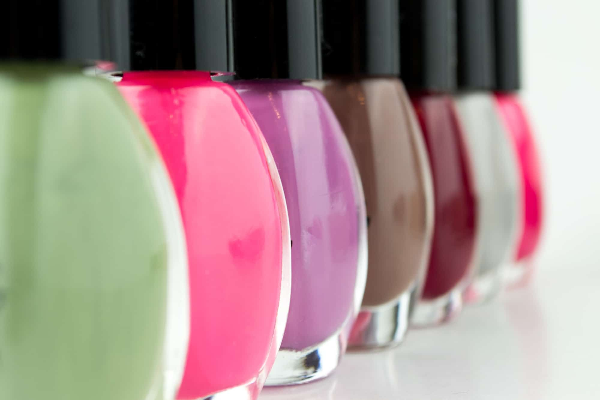 Sideview of 6 bottles of 9 free non-toxic nail polish bottles