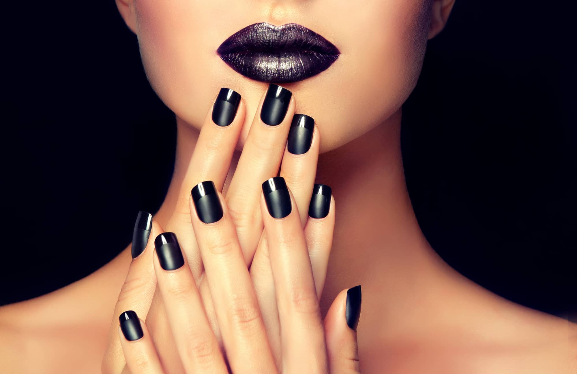 woman with black 9-free non-toxic nail polish and lipstick