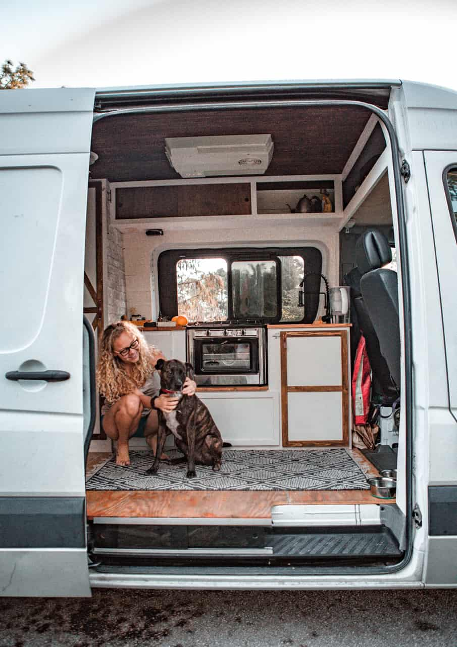 Ashlee Rowland and her dog in her sustainable van