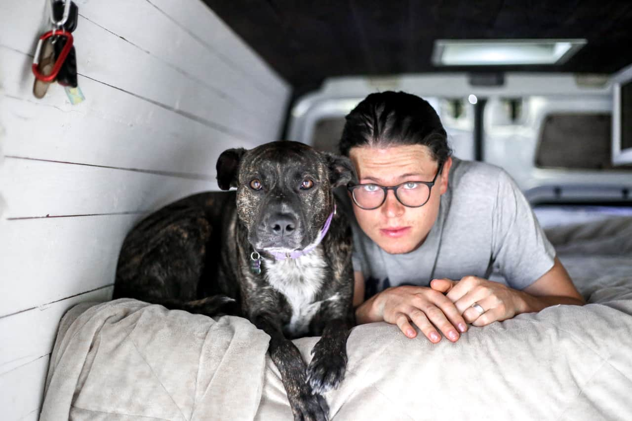 Vanlife: Ashlee Rowlands husband and dog in their sustainable van sleeping quarters