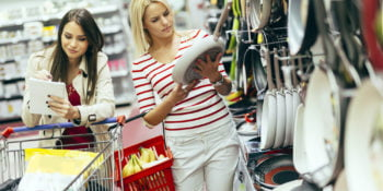Women shopping for cookware in the supermarket