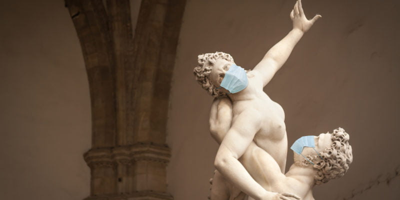 The Kidnapping of the Sabine Women Statue by Giambologna, in the Loggia dei Lanzi in Florence Italy With Face Masks