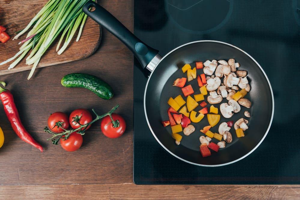 ceramic cookware sauteing carrots & mushrooms