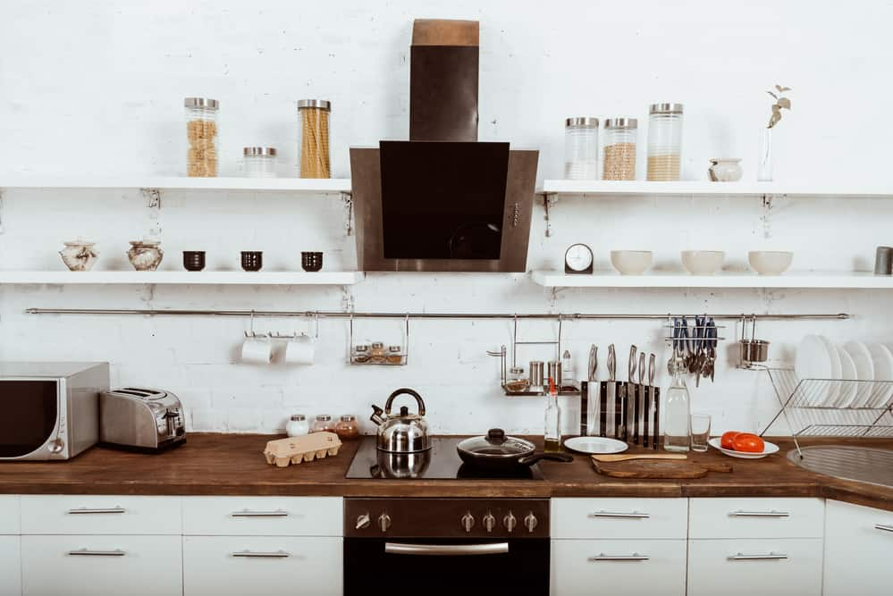 white kitchen with cookware on stove